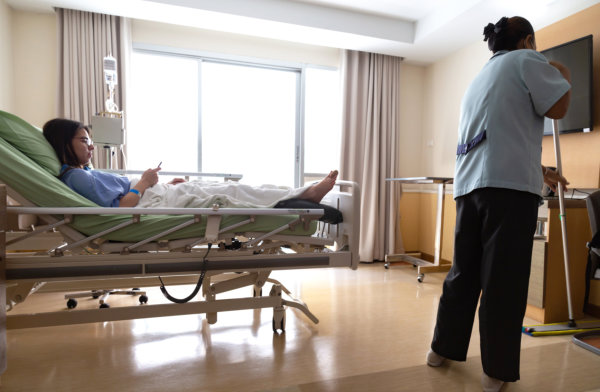 asian hospital room service cleaner woman are cleaning floor with mop