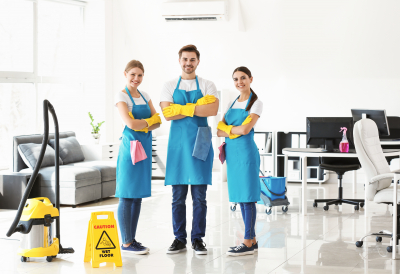 Team of janitors in office