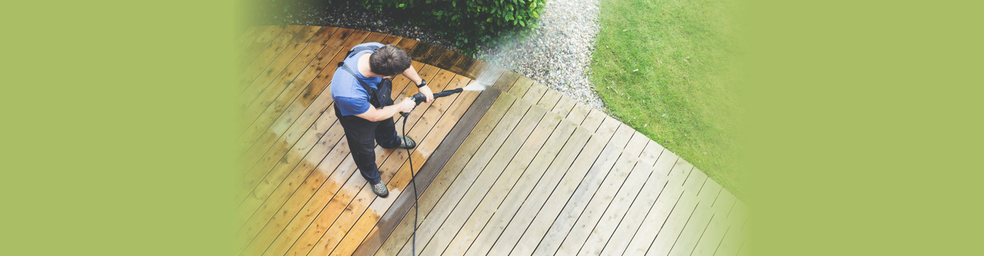man cleaning terrace with a power washer - high water pressure
