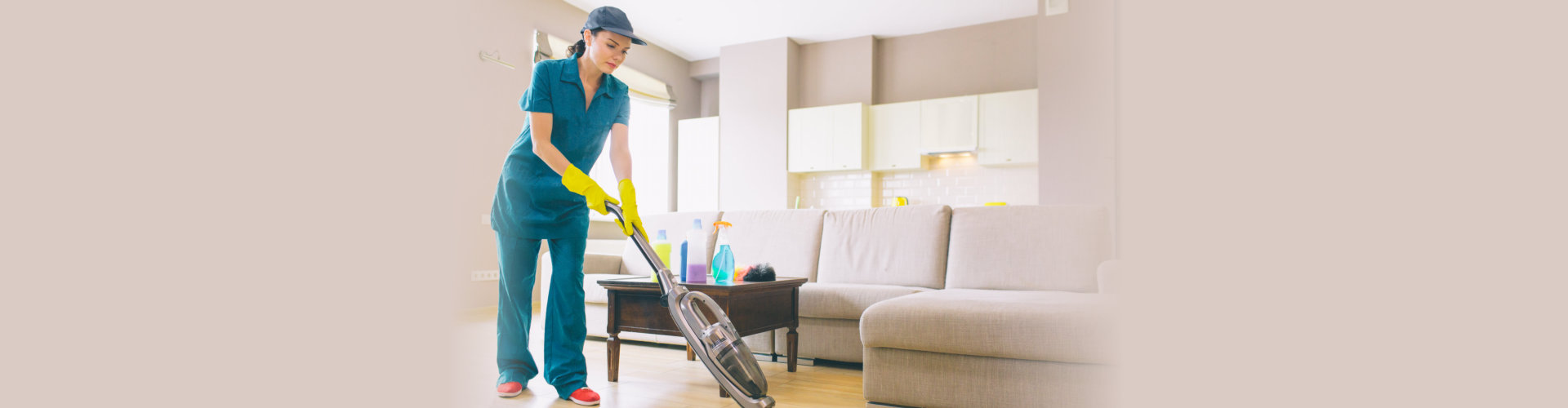 Girl is walking in studio apartment and cleaning floor